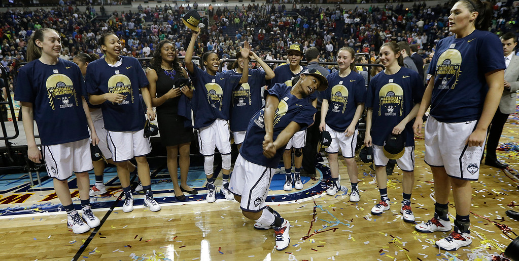 Description of . The Connecticut team celebrate their win over Notre Dame 79-58 after the second half of the championship game in the Final Four of the NCAA women's college basketball tournament, Tuesday, April 8, 2014, in Nashville, Tenn. (AP Photo/Mark Humphrey)