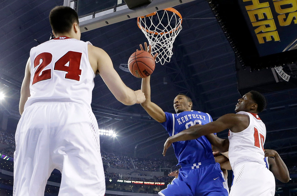 Description of . Wisconsin guard Bronson Koenig (24) and forward Nigel Hayes (10) defend against Kentucky forward Marcus Lee (00) during the first half of the NCAA Final Four tournament college basketball semifinal game Saturday, April 5, 2014, in Arlington, Texas. (AP Photo/Eric Gay)