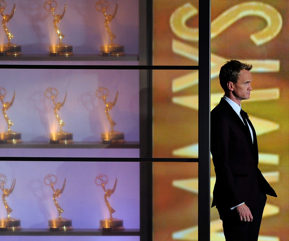 Description of . Host Neil Patrick Harris appears on stage at the 65th Primetime Emmy Awards at Nokia Theatre on Sunday Sept. 22, 2013, in Los Angeles.  (Photo by Chris Pizzello/Invision/AP)