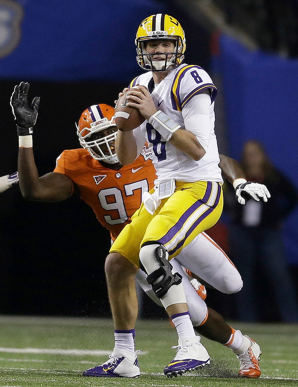 . LSU quarterback Zach Mettenberger (8) prepares to pass the ball under pressure from Clemson defensive end Malliciah Goodman (97) during the first half of the Chick-fil-A Bowl NCAA college football game, Monday, Dec. 31, 2012, in Atlanta. Mettenberger was sacked on the play. (AP Photo/David Goldman)