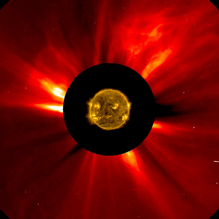 Description of . A combined NASA handout image shows the sun's innermost atmosphere as seen by the Solar Dynamics Observatory (SDO) inside a larger image provided by the Solar and Heliospheric Observatory spacecraft (SOHO) taken November 8-9, 2012. A coronal mass ejection can be seen traveling away from the sun in the upper right corner.  REUTERS/ESA/NASA/Handout