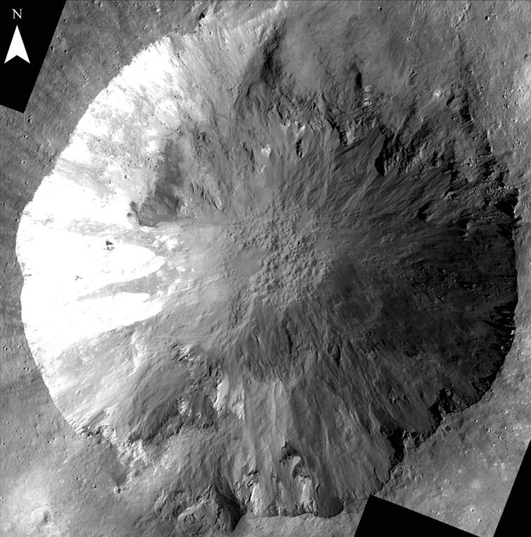 Description of . This image provided by NASA shows long, narrow gullies along the walls of a crater on the giant asteroid Vesta taken by the NASA Dawn spacecraft. Scientists are unclear how these gullies formed and work is underway to determine their origin. (AP Photo/NASA)