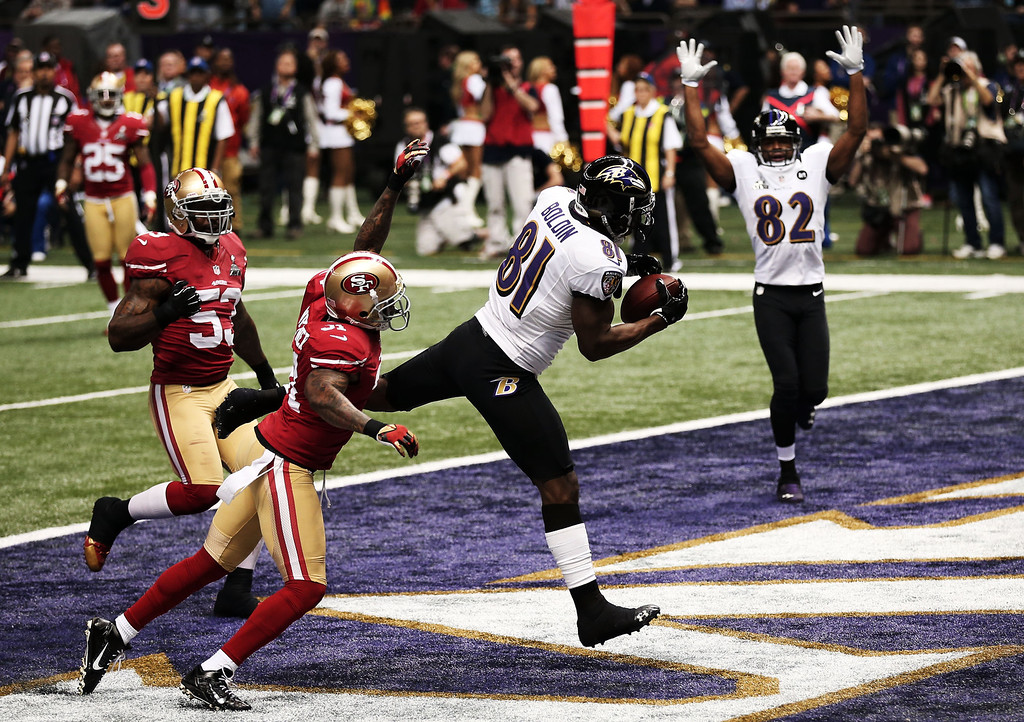 Description of . Anquan Boldin #81 of the Baltimore Ravens makes a 13-yard touchdown reception in the first quarter from Joe Flacco #5 against Donte Whitner #31 of the San Francisco 49ers during Super Bowl XLVII at the Mercedes-Benz Superdome on February 3, 2013 in New Orleans, Louisiana.  (Photo by Win McNamee/Getty Images)
