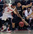 Utah guard Jarred DuBois (5) works to control a loose ball against Colorado guard Askia Booker, right, in the second half during an NCAA college basketball game Saturday, Feb. 2, 2013 in Salt Lake City. Utah beat Colorado 58-55. (AP Photo/Steve C. Wilson)