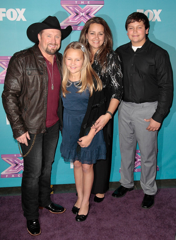 ". Tate Stevens (L-R), winner of Season 2 of ""The X Factor\"", poses with daughter Rylie, wife Ashlie, and son Hayden following Fox\'s \""The X Factor\"" Season Finale - Night 2 at CBS Television City in Los Angeles, California December 20, 2012. REUTERS/Jason Redmond"