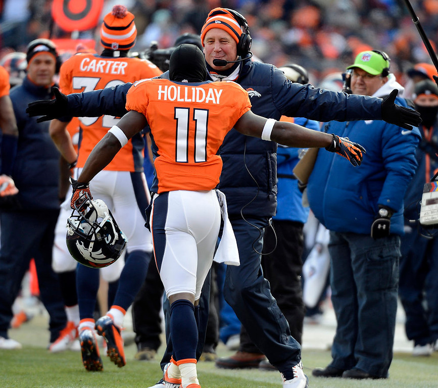 Description of . Denver Broncos wide receiver Trindon Holliday (11) celebrates with Denver Broncos head coach John Fox after scoring a touchdown on an 89 yard punt return early in the first quarter.  The Denver Broncos vs Baltimore Ravens AFC Divisional playoff game at Sports Authority Field Saturday January 12, 2013. (Photo by John Leyba,/The Denver Post)