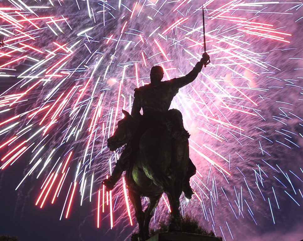 Description of . Fireworks light up the statue of Simon Bolivar during Independence Day celebrations on July 4, 2013 in Washington, DC. Independence Day celebrates the US declaring independence from Britain in 1776. MANDEL NGAN/AFP/Getty Images