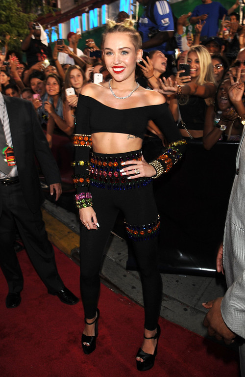 Description of . Miley Cyrus arrives at the MTV Video Music Awards on Sunday, Aug. 25, 2013, at the Barclays Center in the Brooklyn borough of New York. (Photo by Scott Gries/Invision/AP)