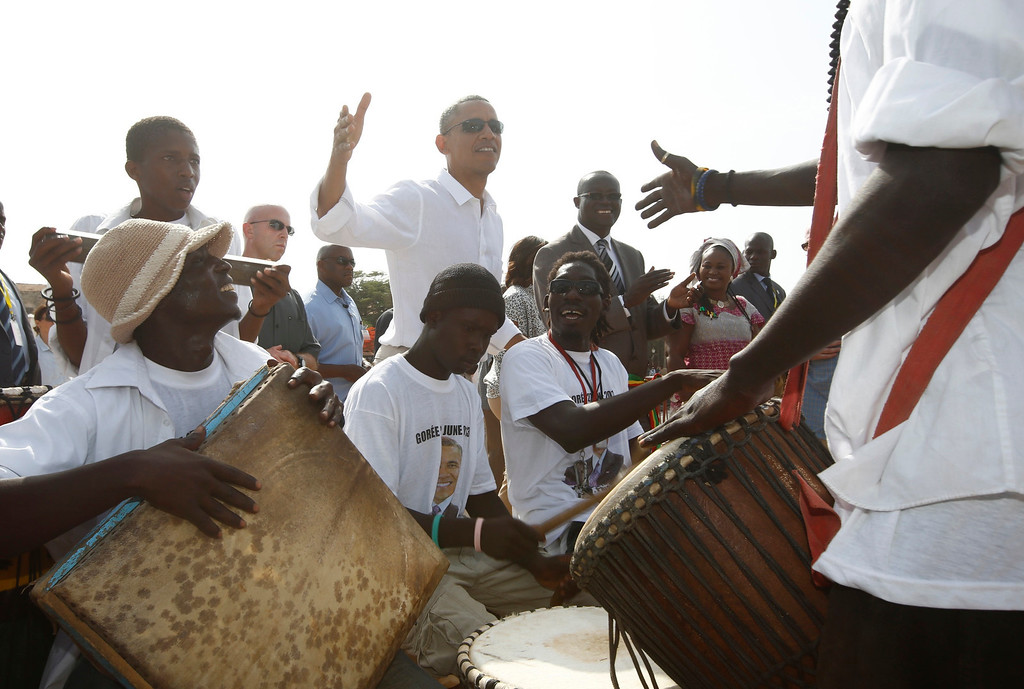 Description of . U.S. President Barack Obama meets with African drummers on Goree Island near Dakar, Senegal, June 27, 2013. Obama visited the island on Thursday where African slaves in past centuries were shipped west.      REUTERS/Jason Reed