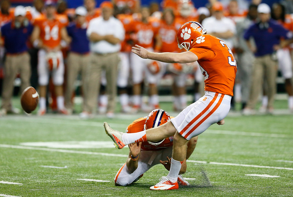 Description of . ATLANTA, GA - JANUARY 01:  Chandler Catanzaro #39 of the Clemson Tigers kicks the game-winning field goal against the LSU Tigers during the 2012 Chick-fil-A Bowl at Georgia Dome on December 31, 2012 in Atlanta, Georgia.  (Photo by Kevin C. Cox/Getty Images)