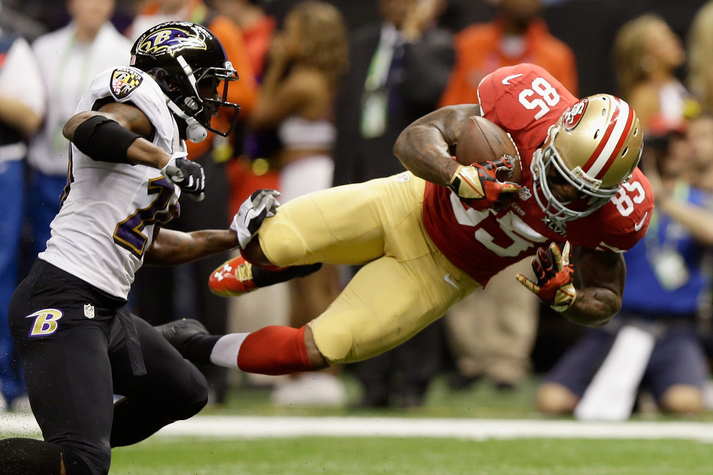 Description of . NEW ORLEANS, LA - FEBRUARY 03: Vernon Davis #85 of the San Francisco 49ers goes airborne after catching a pass against the Baltimore Ravens in the first quarter during Super Bowl XLVII at the Mercedes-Benz Superdome on February 3, 2013 in New Orleans, Louisiana.  (Photo by Ezra Shaw/Getty Images)