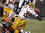 Wide receiver Santana Moss #89 of the Washington Redskins fumbles the ball as he is hit by defensive lineman Jabaal Sheard #97 of the Cleveland Browns at Cleveland Browns Stadium on December 16, 2012 in Cleveland, Ohio.  (Photo by Matt Sullivan/Getty Images)