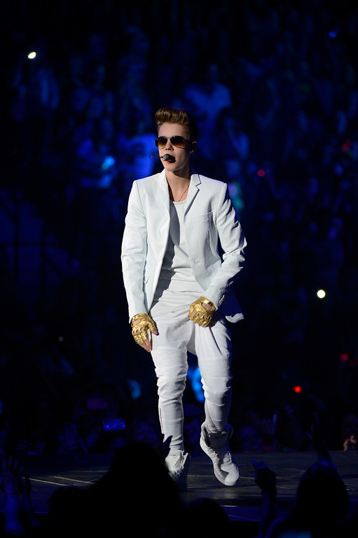 Description of . Justin  Bieber performs to a sold out crowd at Pepsi Center during his  'Believe' Tour stop in Denver. John Leyba, The Denver Post