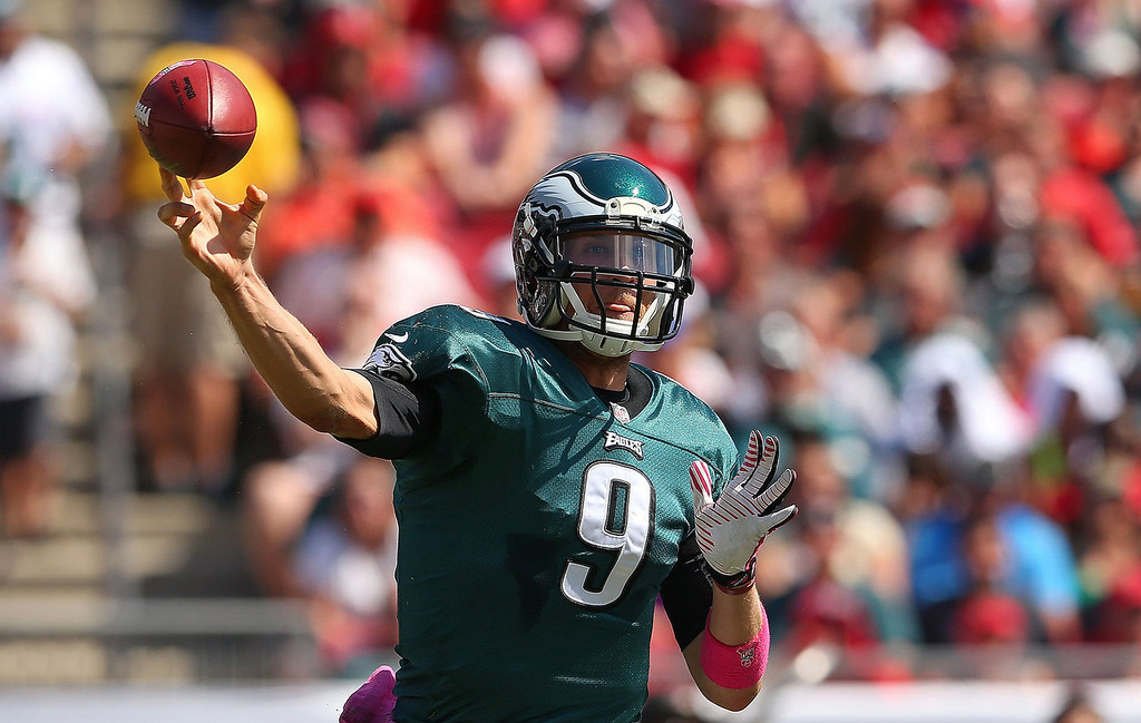 Description of . Nick Foles #9 of the Philadelphia Eagles passes during a game against the Tampa Bay Buccaneers at Raymond James Stadium on October 13, 2013 in Tampa, Florida.  (Photo by Mike Ehrmann/Getty Images)
