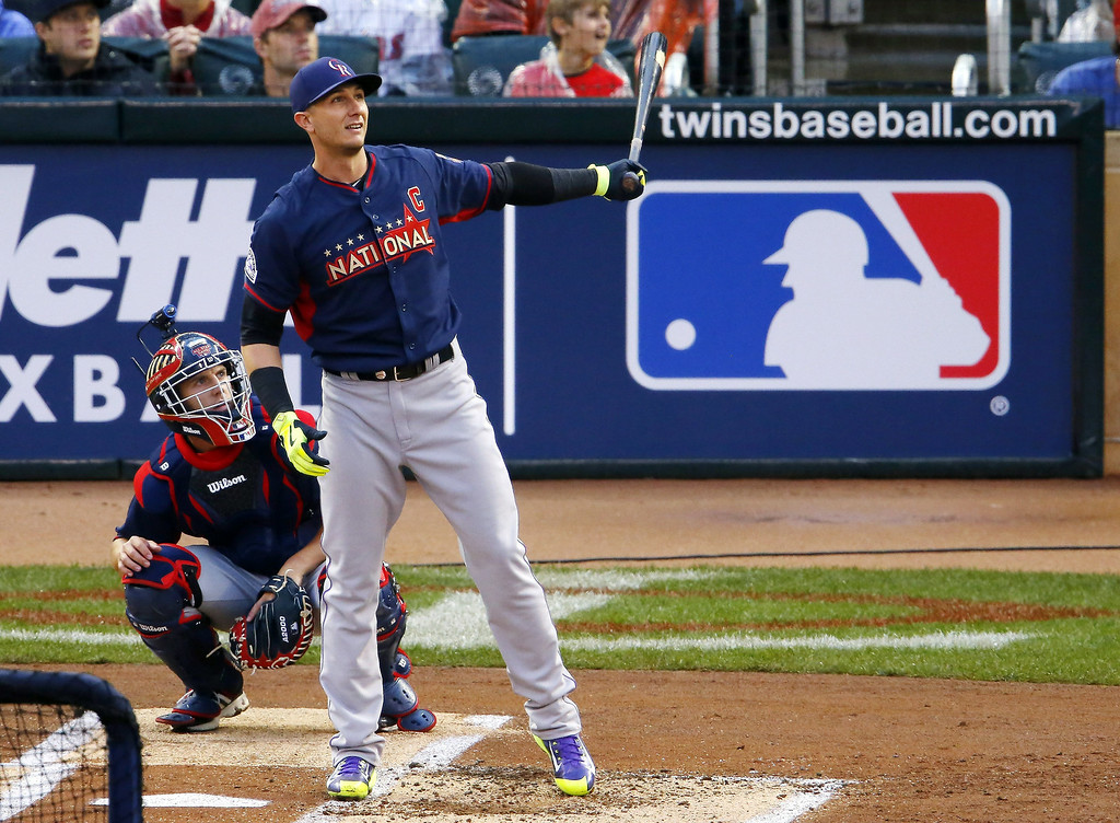 Description of . National League's Troy Tulowitzki, of the Colorado Rockies, hits during the MLB All-Star baseball Home Run Derby, Monday, July 14, 2014, in Minneapolis. (AP Photo/Paul Sancya)
