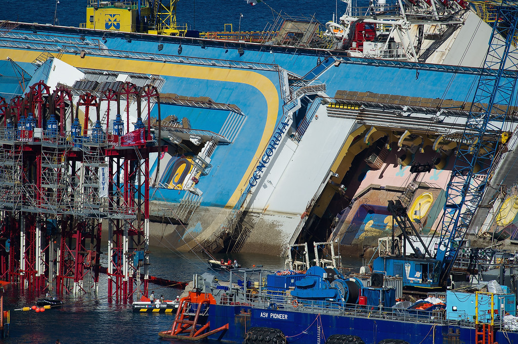Description of . The parbuckling project to raise the stricken Costa Concordia continues on September 16, 2013 in Isola del Giglio, Italy. Work begins today to right the stricken Costa Concordia vessel, which sank on January 12, 2012. If the operation is successful, it will then be towed away and scrapped. The procedure, known as parbuckling, has never been carried out on a vessel as large as Costa Concordia before.  (Photo by Marco Secchi/Getty Images)