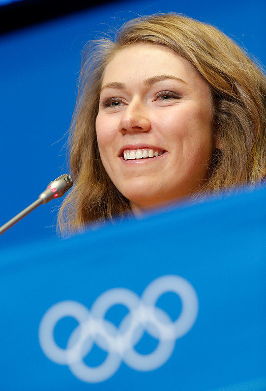 Description of . U.S. skier Mikaela Shiffrin smiles during a U.S. ski team press conference at the Gorki media centre at the Sochi 2014 Winter Olympics, Saturday, Feb. 15, 2014, in Krasnaya Polyana, Russia. Shiffrin, an 18-year-old from Eagle-Vail, Colo., will be favored to win the gold medal in the women's slalom at the Sochi Olympics next week. She's also a contender for a medal in the giant slalom. (AP Photo/Christophe Ena)