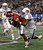 Oklahoma 's Javon Harris (30) intercepts a pass in the end zone intended for Texas A&M's Malcome Kennedy, right, in the first half of the Cotton Bowl NCAA college football game Friday, Jan. 4, 2013, in Arlington, Texas. A&M's Ryan Swope is at left rear. (AP Photo/LM Otero)