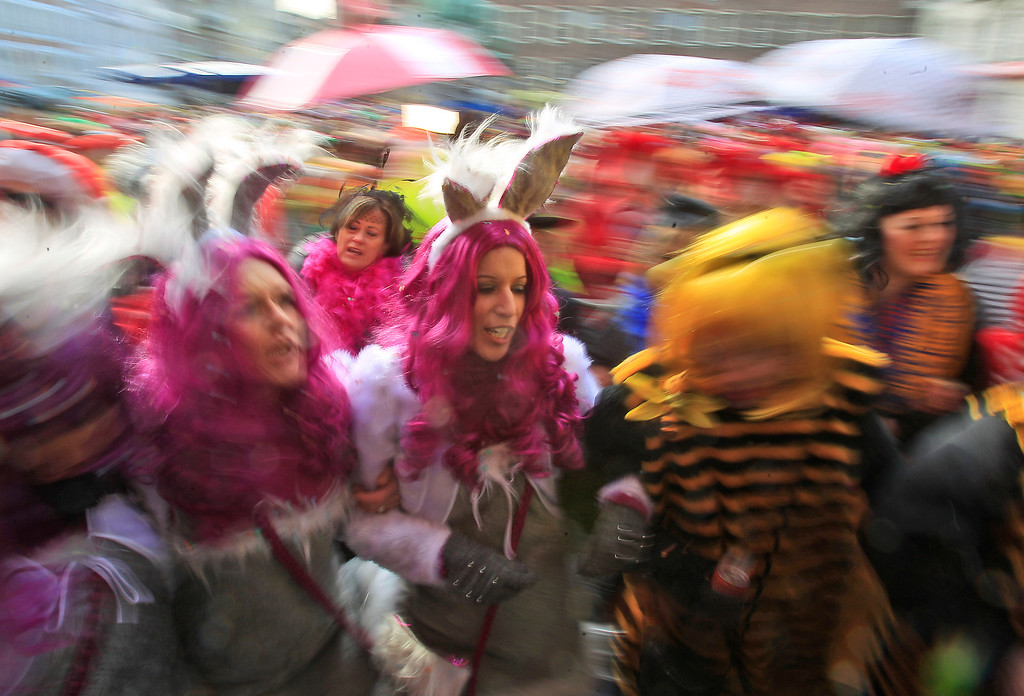 "Description of . Revelers dressed in carnival costumes celebrate the start of the street-carnival with its tradition of entering the town halls and women cutting off men\'s ties with scissors on carnival\'s so called ""Old Women\'s Day\"" in Duesseldorf, Germany, Thursday, Feb. 27, 2014.(AP Photo/Frank Augstein)"