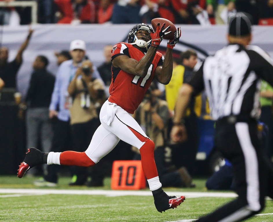 Description of . Atlanta Falcons\' Julio Jones catches a 46-yard touchdown pass during the first half of the NFL football NFC Championship game against the San Francisco 49ers Sunday, Jan. 20, 2013, in Atlanta. (AP Photo/David Goldman)