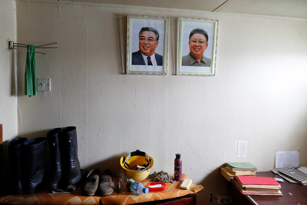 Description of . Portraits of former leader Kim Jong-il (R) and former president Kim Il-sung are seen in one of the rooms inside a North Korean flagged ship