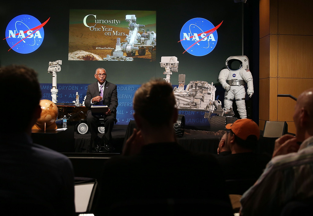 Description of . WASHINGTON, DC - AUGUST 06:  NASA Administrator Charles Bolden speaks about the Curiosity rover during an event at NASA headquarters, August 6, 2013 in Washington, DC. The event was held to observe the first anniversary of NASA's Curiosity rover landing on Mars.  (Photo by Mark Wilson/Getty Images)
