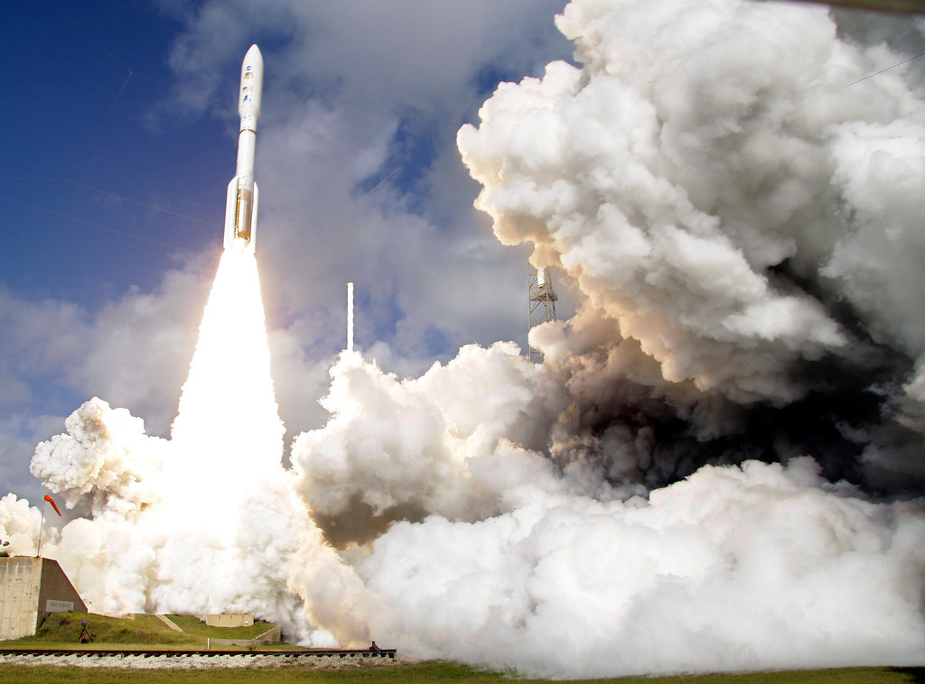 Description of . FILE - In this Saturday, Nov. 26, 2011 file photo, a United Launch Alliance Atlas V rocket carrying NASA's Mars Science Laboratory (MSL) Curiosity rover lifts off from Launch Complex 41at Cape Canaveral Air Force Station in Cape Canaveral, Fla. (AP Photo/Terry Renna)