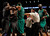 Boston Celtics forward Kevin Garnett (R) is separated by teammates and officials from Brooklyn Nets forward Gerald Wallace (L) in the fourth quarter of their NBA basketball game in New York, December 25, 2012.    REUTERS/Adam Hunger