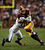 Robert Griffin III #10 of the Washington Redskins is tackled by  Leroy Hill #56 of the Seattle Seahawks during the NFC Wild Card Playoff Game at FedExField on January 6, 2013 in Landover, Maryland.  (Photo by Win McNamee/Getty Images)
