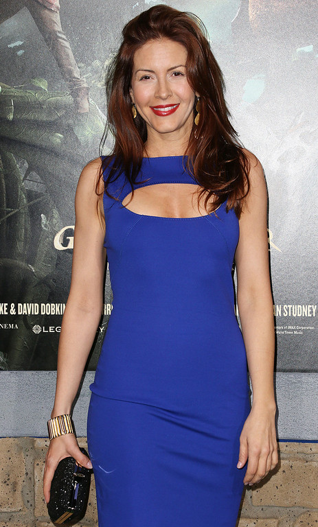 """Description of . Michelle Clunie attends the Premiere Of New Line Cinema\'s \""""Jack The Giant Slayer\"""" at the TCL Chinese Theatre on February 26, 2013 in Hollywood, California.  (Photo by Frederick M. Brown/Getty Images)"""