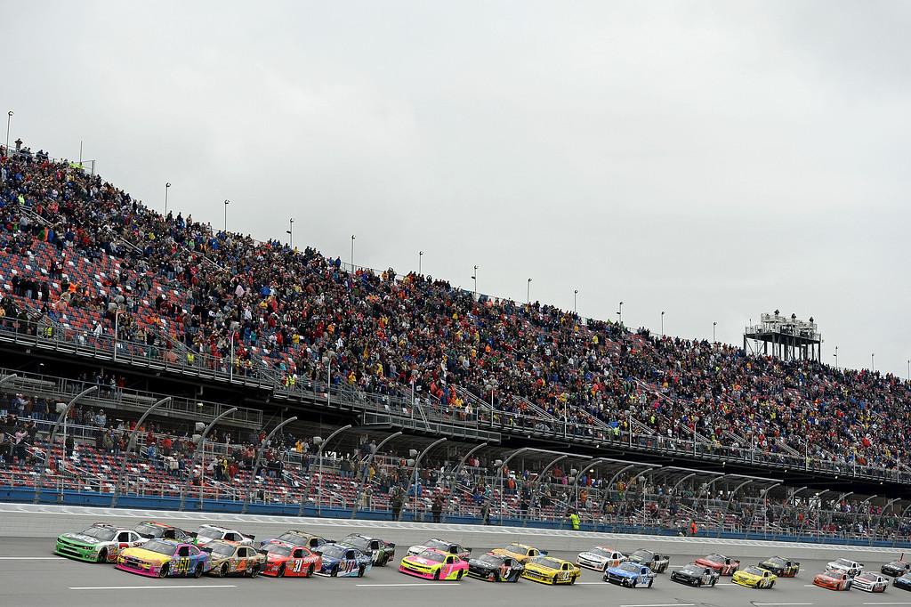 Description of . TALLADEGA, AL - MAY 04:  (Front row cars L-R) Austin Dillon, driver of the #3 AdvoCare Chevrolet and Travis Pastrana, driver of the #60 Roush Fenway Racing Ford, lead the field at the start of the NASCAR Nationwide Series Aaron's 312 at Talladega Superspeedway on May 4, 2013 in Talladega, Alabama.  (Photo by Patrick Smith/Getty Images)