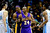 Los Angeles Lakers shooting guard Kobe Bryant (24) wipes his hands on his jersey as center Dwight Howard (12) leans over his shoulder against before the first half against the Denver Nuggets at the Pepsi Center on Wednesday, December 26, 2012. AAron Ontiveroz, The Denver Post