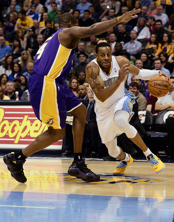 Description of . Denver Nuggets' Andre Iguodala (R) drives in for a shot on Los Angeles Lakers' Antawn Jamison (L) during their NBA basketball game in Denver, Colorado February 25, 2013.   REUTERS/Mark Leffingwell