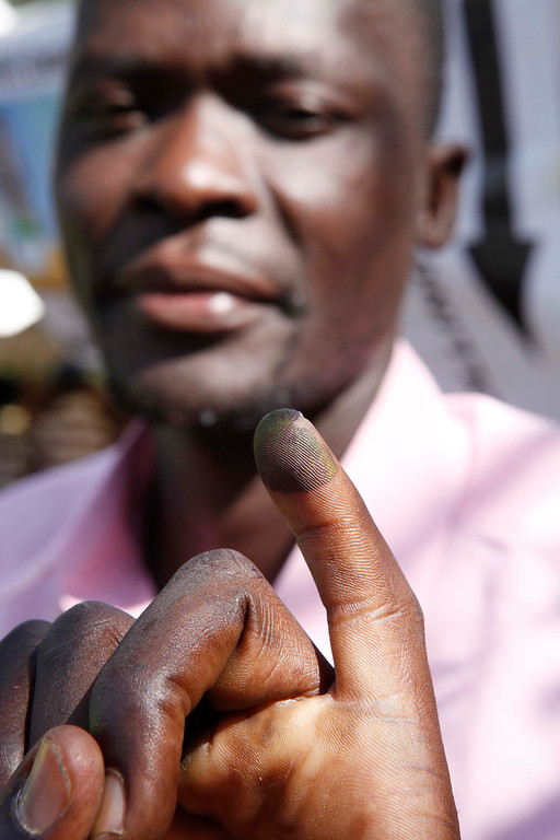 Description of . A man shows his marked finger after he voted at a polling station in Kisumu, western Kenya on March 4, 2013 during the nationwide elections. Long lines of Kenyans queued from way before dawn to vote Monday in the first election since the violence-wracked polls five years ago, with a deadly police ambush hours before polling started marring the key ballot. The tense elections are seen as a crucial test for Kenya, with leaders vowing to avoid a repeat of the bloody 2007-8 post-poll violence in which over 1,100 people were killed and observers repeatedly warning of the risk of renewed conflict.      Till Muellenmeister/AFP/Getty Images