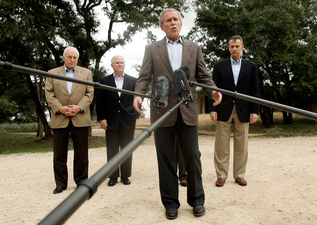 "Description of . President Bush, center, stands with, from left,  Vice President Dick Cheney, Defense Secretary Robert Gates, and Chairman of the Joint Chiefs of Staff Gen. Peter Pace as he talks with reporters about a meeting with his national security team Thursday, Dec. 28, 2006 in Crawford, Texas.   Bush met with his national security team at his Texas ranch, and declared he had moved one step closer to devising a new Iraq strategy but would seek more advice before settling on a final plan. ""We\'re making good progress,\"" Bush said. (AP Photo/Evan Vucci)"