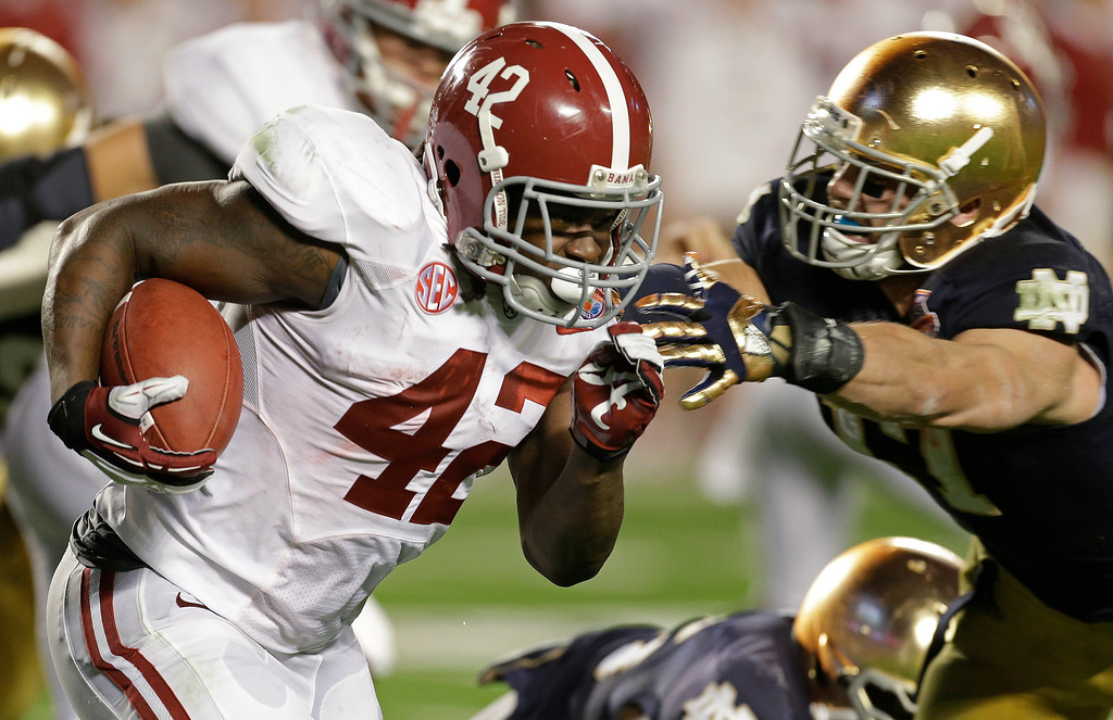 Description of . Alabama's Eddie Lacy runs during the first half of the BCS National Championship college football game against Notre Dame Monday, Jan. 7, 2013, in Miami. (AP Photo/Chris O'Meara)