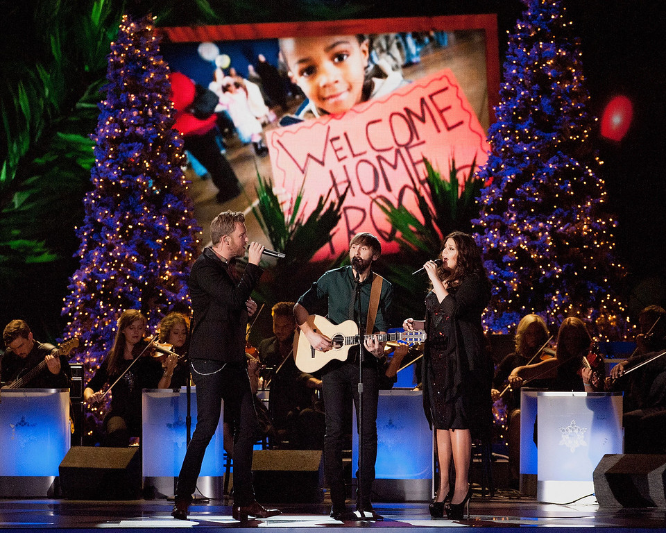 Description of . (L-R)Charles Kelley,  Dave Haywood and Hillary Scott of Lady Antebellum perform during the CMA 2013 Country Christmas on November 8, 2013 in Nashville, Tennessee.  (Photo by Erika Goldring/Getty Images)