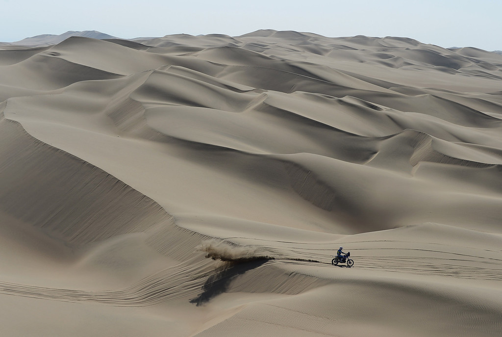 Description of . PISCO, PERU - JANUARY 07:  A Rider crosses the dunes during the stage from Pisco to Nazca on day three of the 2013 Dakar Rally on January 7, 2013 in Pisco, Peru.  (Photo by Shaun Botterill/Getty Images)