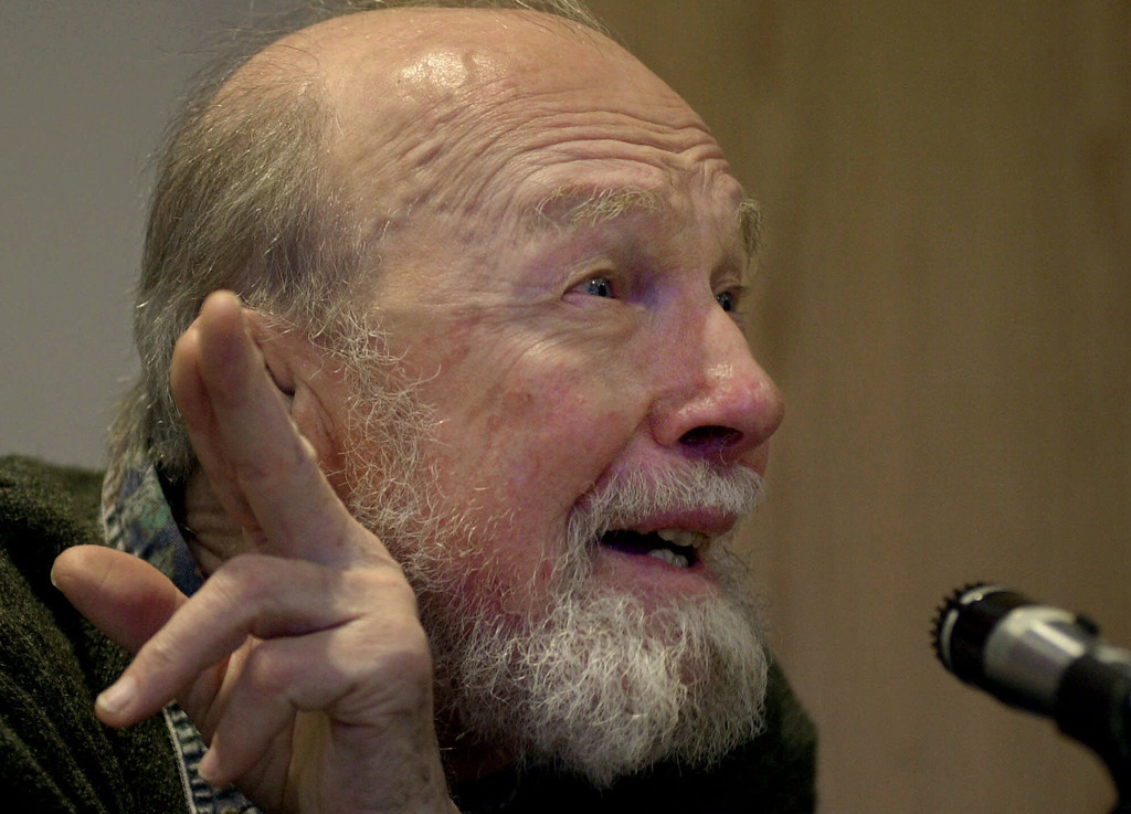 Description of . Legendary folk singer and social activist Pete Seeger, 81, speaks to students and faculty Monday, Jan. 29, 2001, during a forum at  Brandeis University in Waltham, Mass., called