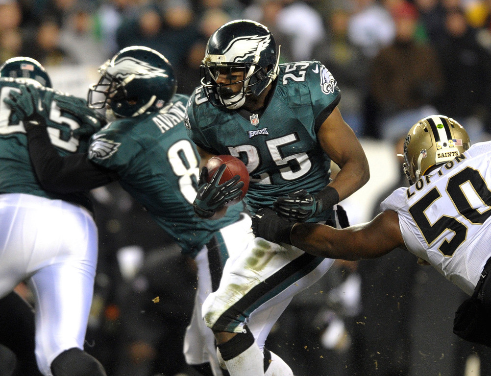 Description of . Philadelphia Eagles running back LeSean McCoy runs through as hole as New Orleans Saints linebacker Curtis Lofton defends during an NFL football wild-card playoff game Saturday, Jan. 4, 2014, in Philadelphia. The Saints won 26-24. (AP Photo/The Express-Times, Matt Smith)