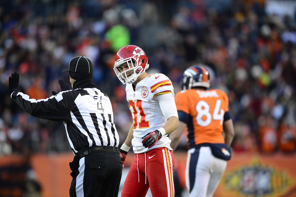 Description of . Kansas City Chiefs free safety Tysyn Hartman (31) argues with the referee in the third quarter as the Denver Broncos took on the Kansas City Chiefs at Sports Authority Field at Mile High in Denver, Colorado on December 30, 2012. AAron Ontiveroz, The Denver Post