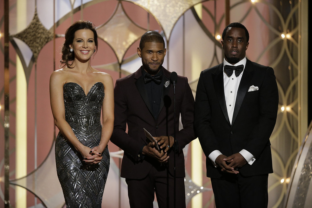 Description of . In this handout photo provided by NBCUniversal, (L-R) Presenters  Kate Beckinsale, Usher and Sean Diddy Combs speak onstage during the 71st Annual Golden Globe Award at The Beverly Hilton Hotel on January 12, 2014 in Beverly Hills, California.  (Photo by Paul Drinkwater/NBCUniversal via Getty Images)
