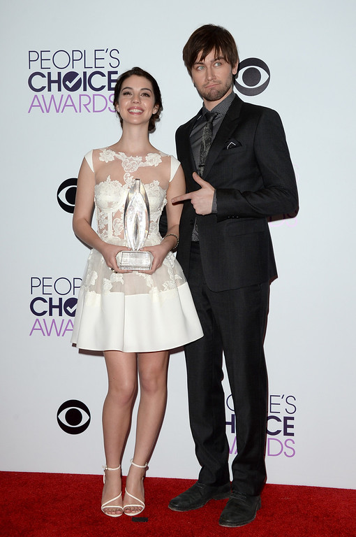 Description of . LOS ANGELES, CA - JANUARY 08:  Actors Adelaide Kane (L) and Torrance Coombs, winners of the Favorite New TV Drama award for 'Reign,' pose in the press room at The 40th Annual People's Choice Awards at Nokia Theatre L.A. Live on January 8, 2014 in Los Angeles, California.  (Photo by Jason Merritt/Getty Images)