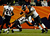 Denver Broncos running back Ronnie Hillman (21) gets hit from behind and taken down by Baltimore Ravens inside linebacker Ray Lewis (52) and Baltimore Ravens defensive back Chykie Brown (23) during the second half.  The Denver Broncos vs Baltimore Ravens AFC Divisional playoff game at Sports Authority Field Saturday January 12, 2013. (Photo by Joe Amon,/The Denver Post)