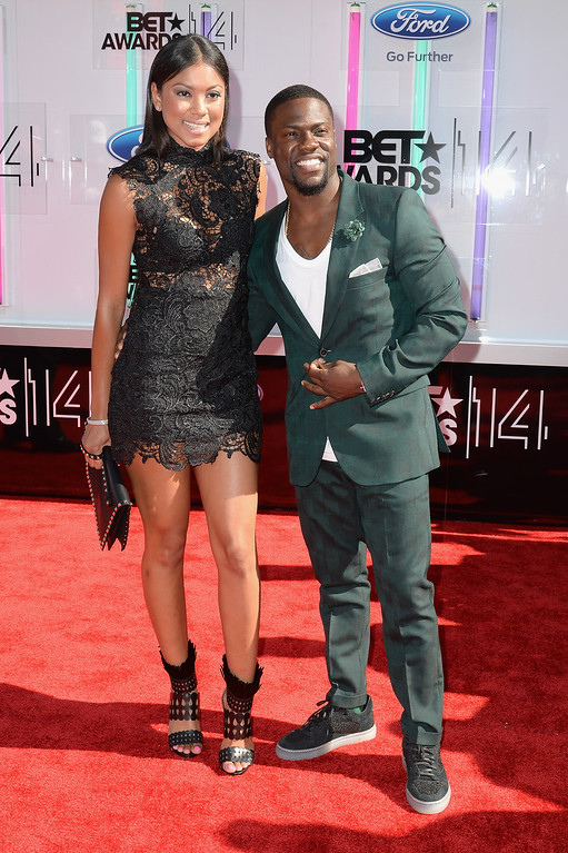 Description of . Actor Kevin Hart (R) and Eniko Parrish attend the BET AWARDS '14 at Nokia Theatre L.A. LIVE on June 29, 2014 in Los Angeles, California.  (Photo by Earl Gibson III/Getty Images for BET)