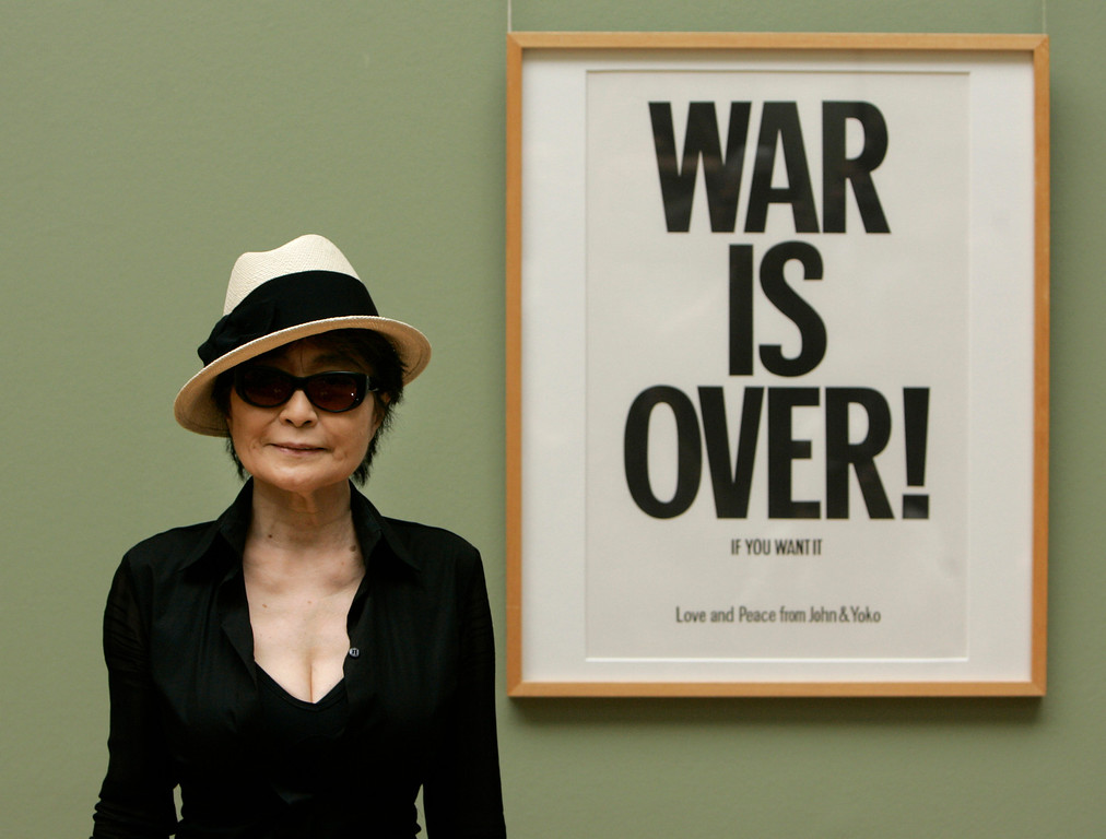 Description of . Artist Yoko Ono poses next to one of her works 'War is over! If you want it - Love and Peace from John an Yoko' in the museum of arts (Kunsthalle) in Bremen, northern Germany, on Tuesday, June 12, 2007. The widow of John Lennon shows her 'Instructions for Paintings' works at the museum until Aug. 5, 2007.(AP Photo/Joerg Sarbach)