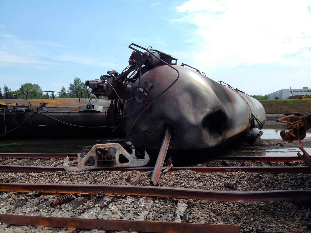 Description of . A burnt train car is seen after a train derailment and explosion in Lac-Megantic, Quebec July 8, 2013  in this picture provided by the Transportation Safety Board of Canada.   REUTERS/Transportation Safety Board of Canada/Handout via Reuters (