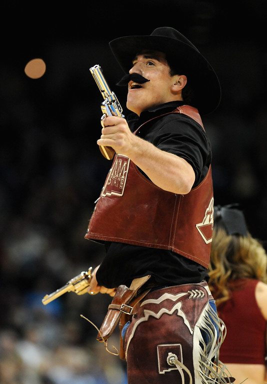 Description of . The New Mexico State Aggies mascot performs during the second round of the 2014 NCAA Men's Basketball Tournament against the San Diego State Aztecs at Spokane Veterans Memorial Arena on March 20, 2014 in Spokane, Washington.  (Photo by Steve Dykes/Getty Images)