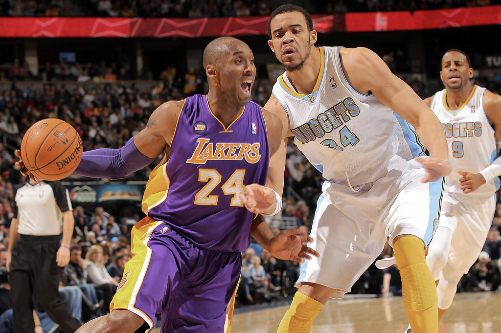 Description of . Kobe Bryant #24 of the Los Angeles Lakers drives to the basket against JaVale McGee #34 of the Denver Nuggets at the Pepsi Center on February 25, 2013 in Denver, Colorado. NOTE TO USER: User expressly acknowledges and agrees that, by downloading and or using this photograph, User is consenting to the terms and conditions of the Getty Images License Agreement.  (Photo by Doug Pensinger/Getty Images)