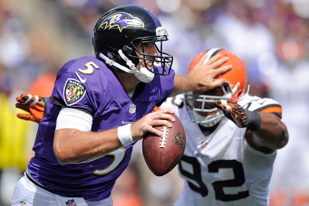 Description of . Baltimore Ravens quarterback Joe Flacco (5) pushes off Cleveland Browns defensive end Desmond Bryant's helmet during the first half of a NFL football game in Baltimore, Md., Sunday Sept. 15, 2013. (AP Photo/Nick Wass)